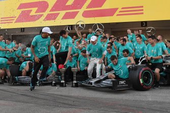 The Mercedes team celebrates after clinching their record 6th consecutive Constructors title