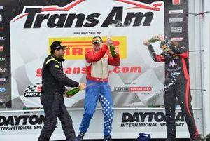 TA podium finishers RJ Lopez, David Pintaric, and Amy Ruman