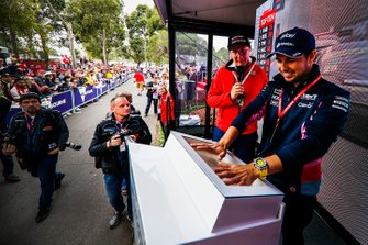 Sergio Perez, Racing Point, makes hand prints