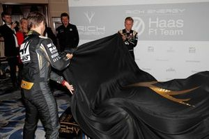 Romain Grosjean, Haas F1 Team and Kevin Magnussen, Haas F1 Team unveil the new livery on the Haas F1 Team VF-18