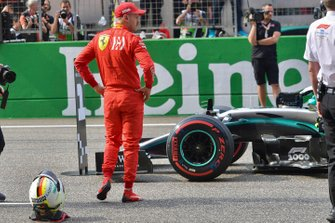 Sebastian Vettel, Ferrari, inspects the rival Mercedes AMG F1 W10