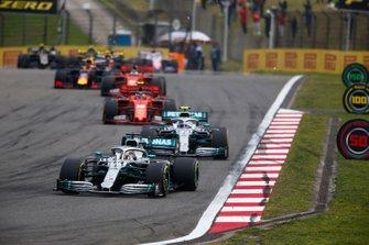 Lewis Hamilton, Mercedes AMG F1 W10, leads Valtteri Bottas, Mercedes AMG W10, Charles Leclerc, Ferrari SF90, Sebastian Vettel, Ferrari SF90, and Max Verstappen, Red Bull Racing RB15