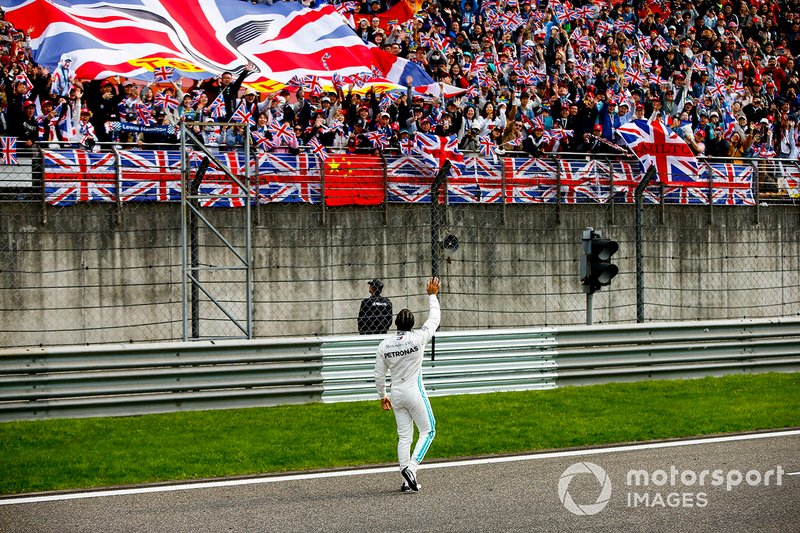 Lewis Hamilton, Mercedes AMG F1, 1st position, celebrates with fans on the track at the end of the race