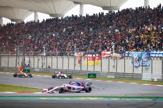 Sergio Perez, Racing Point RP19, leads Kimi Raikkonen, Alfa Romeo Racing C38, and Lando Norris, McLaren MCL34
