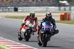 Jorge Lorenzo, Yamaha Factory Racing just before Andrea Iannone, Ducati Team crashes in to him