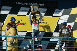 Podium: race winner Tohru Ukawa, second place Valentino Rossi, third place Loris Capirossi