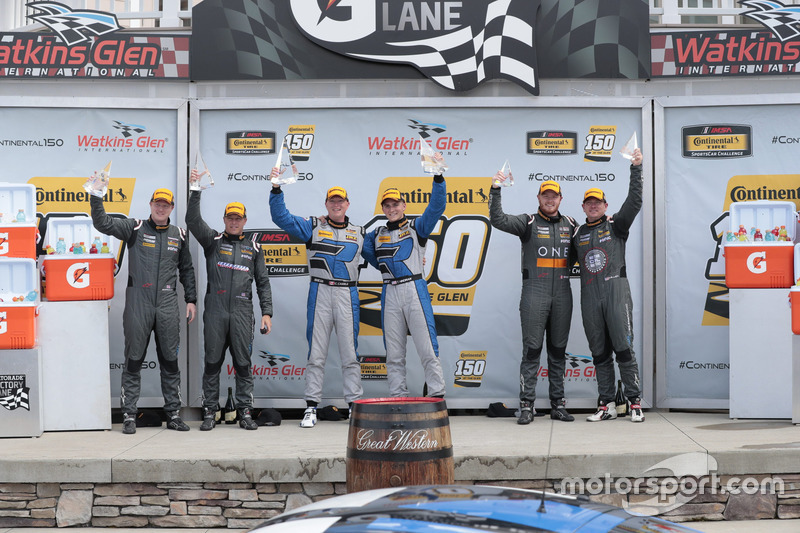 Podium: race winners Cameron Cassels, Trent Hindman, Bodymotion Racing, second place Tyler McQuarrie, Tilt Bechtolscheimer, CJ Wilson Racing, third place Daniel Burkett, Marc Miller, CJ Wilson Racing