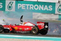 Sebastian Vettel, Ferrari SF16-H and Nico Rosberg, Mercedes AMG F1 W07 Hybrid collide at the start o