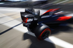 Fernando Alonso, McLaren exits the pit garage.