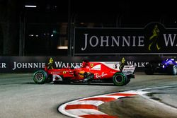 The damaged car of Sebastian Vettel, Ferrari SF70H