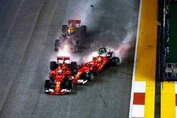 Sparks fly as Kimi Raikkonen, Ferrari SF70H hits Max Verstappen, Red Bull Racing RB13 and Sebastian