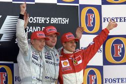 Podium: winner David Coulthard, McLaren, second place Mika Hakkinen, McLaren, third place Michael Sc