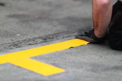 Pit stop markings applied to the ground