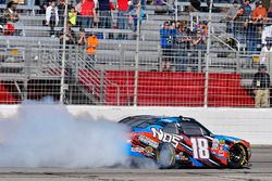 Kyle Busch, Joe Gibbs Racing Toyota celebrates his win with a burnout