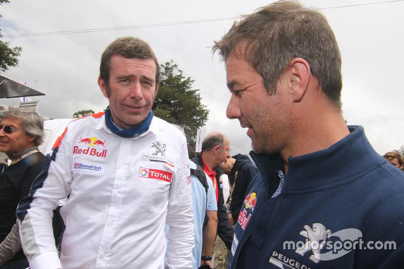 Bruno Famin, jefe de Peugeot Sport, y Sébastien Loeb