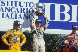 Podium: race winner Nelson Piquet, Williams, second place Ayrton Senna, Team Lotus, third place Nige