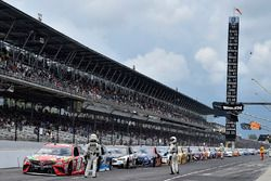 Kyle Busch, Joe Gibbs Racing Toyota, the field parked on pit road for a rain delay