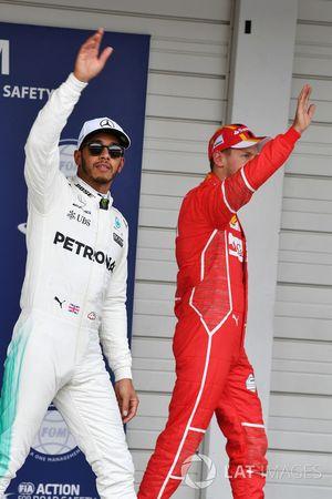 Lewis Hamilton, Mercedes AMG F1 and Sebastian Vettel, Ferrari celebrate in parc ferme