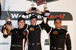 P podium: third place Helio Castroneves, Simon Pagenaud, Juan Pablo Montoya, Team Penske
