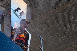 Daniel Ricciardo, Red Bull Racing celebrates on the podium with the champagne