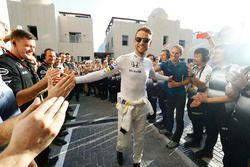 Jenson Button, McLaren walks to the garage to the cheers of his team