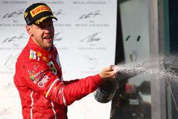 Podium: winner Sebastian Vettel, Ferrari celebrates with champagne