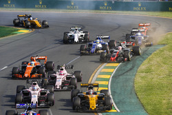 Nico Hulkenberg, Renault Sport F1 Team RS17, leads Sergio Perez, Force India VJM10, Esteban Ocon, Force India VJM10, and Fernando Alonso, McLaren MCL32, as Kevin Magnussen, Haas F1 Team VF-17, and Marcus Ericsson, Sauber C36, get scruffy at the back
