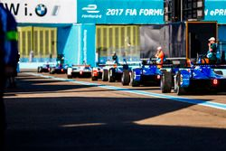 Cars queue in the pit lane