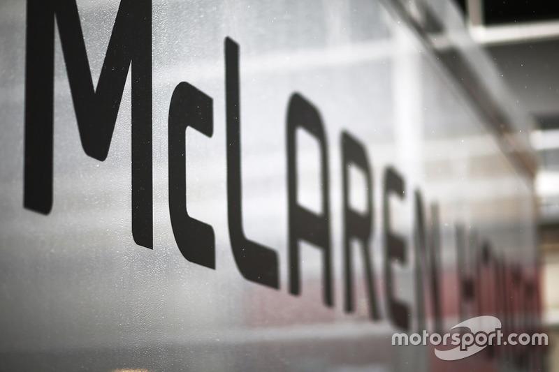 Rain falls on the McLaren Honda trucks in the paddock