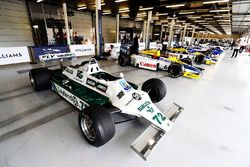 A Williams FW07B, Williams FW10 Honda, FW11, other classic machinery line-up in the Silverstone pit garage
