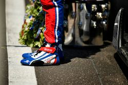 Takuma Sato, Andretti Autosport Honda stands on the finish line with the Borg-Warner Trophy and wrea