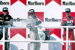 Podium: Race winner Nelson Piquet, Williams, second place Ayrton Senna, Lotus, third place Nigel Mansell, Williams