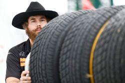 Stylish character pushing tires