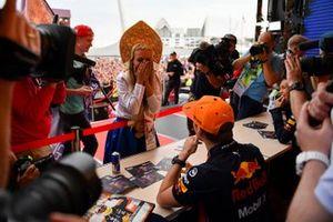 Max Verstappen, Red Bull Racing, meets an enthusiastic fan