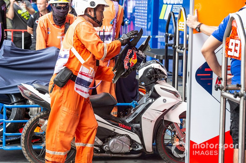 Marc Marquez, Repsol Honda Team, crashed bike covered up