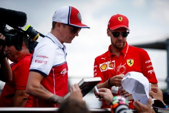Kimi Raikkonen, Alfa Romeo Racing and Sebastian Vettel, Ferrari on the drivers parade truck
