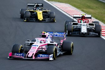 Lance Stroll, Racing Point RP19, leads Antonio Giovinazzi, Alfa Romeo Racing C38, and Daniel Ricciardo, Renault F1 Team R.S.19