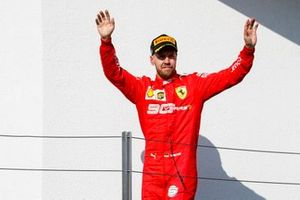 Sebastian Vettel, Ferrari, 3rd position, arrives on the podium