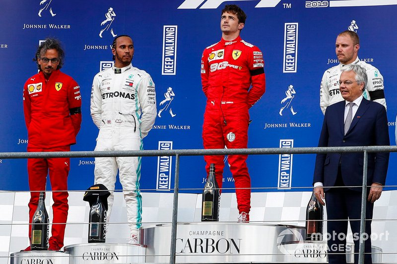 Charles Leclerc, Ferrari, celebrates on the podium with Lewis Hamilton, Mercedes AMG F1 and Valtteri Bottas, Mercedes AMG F1