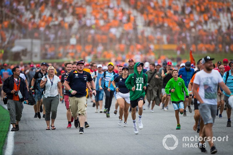 Fans invade the circuit to celebrate at the end of the race