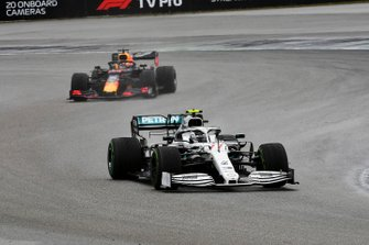 Valtteri Bottas, Mercedes AMG W10, leads Max Verstappen, Red Bull Racing RB15