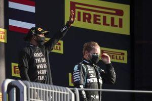 Lewis Hamilton, Mercedes-AMG F1, 1st position, and Valtteri Bottas, Mercedes-AMG F1, 2nd position, on the podium