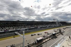 Valtteri Bottas, Mercedes F1 W11, and Lewis Hamilton, Mercedes F1 W11, lead the field towards the first corner
