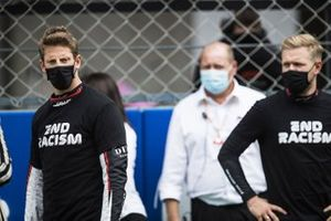 Romain Grosjean, Haas F1, and Kevin Magnussen, Haas F1, on the grid