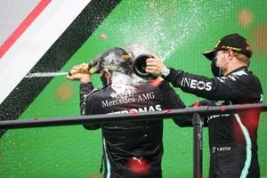 Race Winner Lewis Hamilton, Mercedes-AMG F1 and Valtteri Bottas, Mercedes-AMG F1 celebrate on the podium with the chamapagne