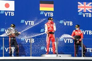Yuki Tsunoda, Carlin, Race Winner Mick Schumacher, Prema Racing and Callum Ilott, UNI-Virtuosi celebrate on the podium with the champagne on the podium