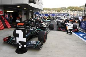 Pole Sitter Lewis Hamilton, Mercedes F1 W11, Max Verstappen, Red Bull Racing RB16 and Valtteri Bottas, Mercedes F1 W11 drive into Parc Ferme