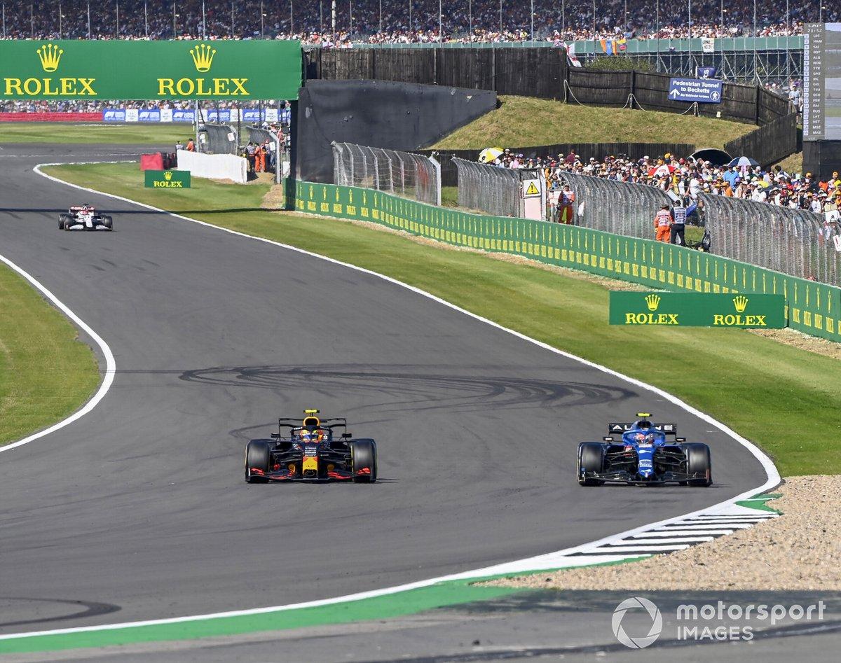 Sergio Perez, Red Bull Racing RB16B , Esteban Ocon, Alpine A521