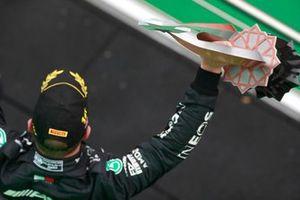 Valtteri Bottas, Mercedes, 1st position, lifts his trophy on the podium