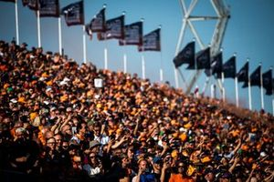 Fans take photos from the grandstands after a win for Max Verstappen, Red Bull Racing